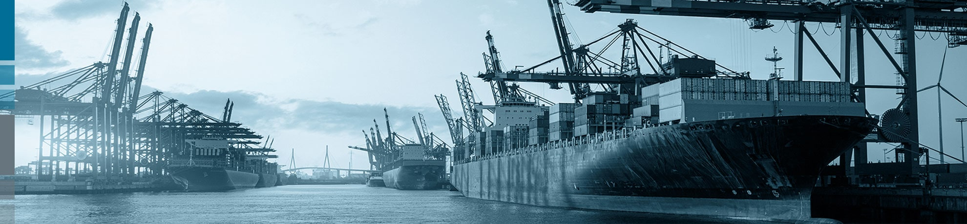 Port of Hamburg with Köhlbrand Bridge and container ships as a symbol for the Feddersen Group's overseas trade.