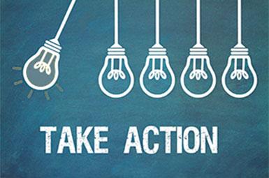 Fünf Glühbirnen und der Schriftzug Take Action